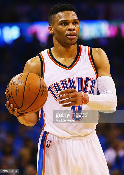 Russell Westbrook of the Oklahoma City Thunder handles the ball during the first half against the Golden State Warriors in game six of the Western...