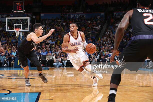 Russell Westbrook of the Oklahoma City Thunder handles the ball against the Phoenix Suns on October 28 2016 at the Chesapeake Energy Arena in...
