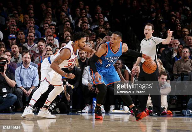 Russell Westbrook of the Oklahoma City Thunder handles the ball during the game against Derrick Rose of the New York Knicks on November 28 2016 at...