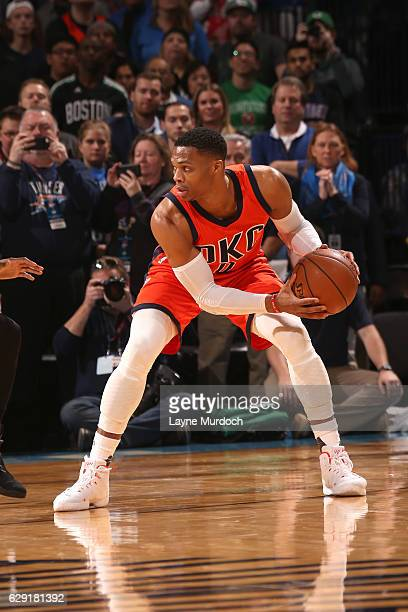 Russell Westbrook of the Oklahoma City Thunder handles the ball against the Boston Celtics on December 11 2016 at Chesapeake Energy Arena in Oklahoma...