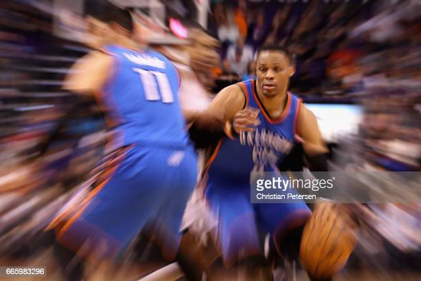 Russell Westbrook of the Oklahoma City Thunder handles the ball during the first half of the NBA game against the Phoenix Suns at Talking Stick...