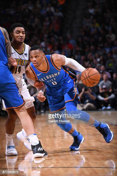 Russell Westbrook of the Oklahoma City Thunder handles the ball against the Denver Nuggets on November 9 2017 at the Pepsi Center in Denver Colorado...
