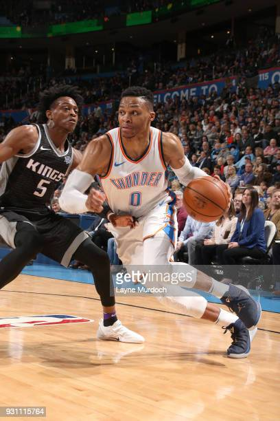 Russell Westbrook of the Oklahoma City Thunder handles the ball against the Sacramento Kings on March 12 2018 at Chesapeake Energy Arena in Oklahoma...