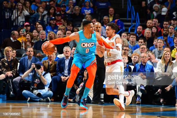 Russell Westbrook of the Oklahoma City Thunder handles the ball against Trae Young of the Atlanta Hawks on November 30 2018 at Chesapeake Energy...