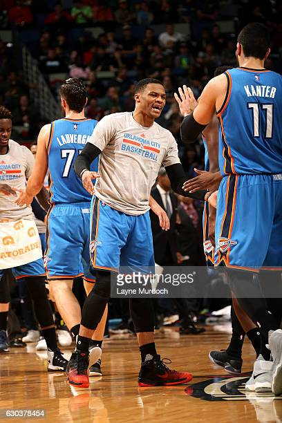 Russell Westbrook of the Oklahoma City Thunder high fives his teammates during the game against the New Orleans Pelicans on December 21 2016 at the...
