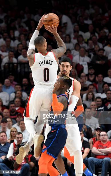 Russell Westbrook of the Oklahoma City Thunder hits a shit over Dennis Schroder of the Oklahoma City Thunder during the first half of Game Five of...