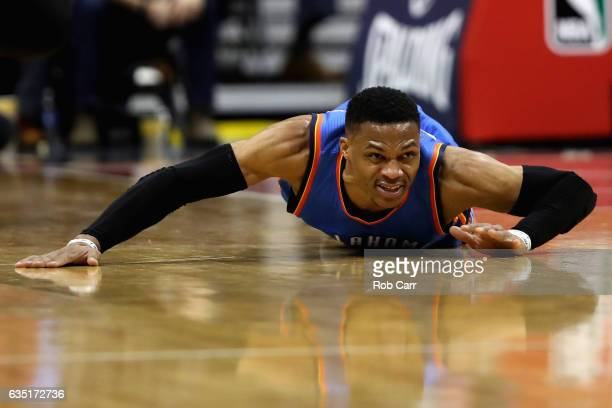 Russell Westbrook of the Oklahoma City Thunder hits the floor going after a loose ball in the first half against the Washington Wizards at Verizon...