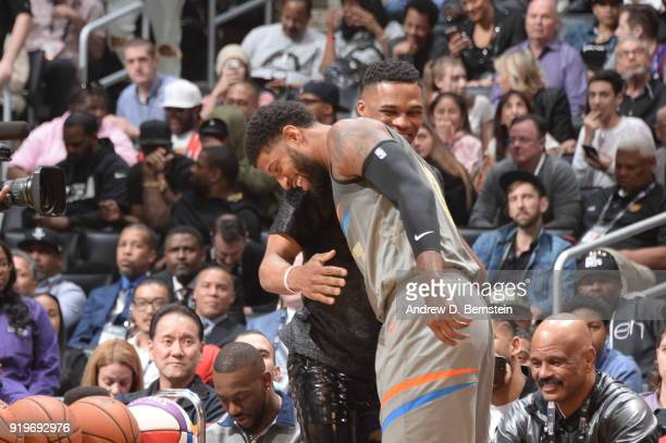 Russell Westbrook of the Oklahoma City Thunder hugs Paul George of the Oklahoma City Thunder during the JBL ThreePoint Contest during State Farm...