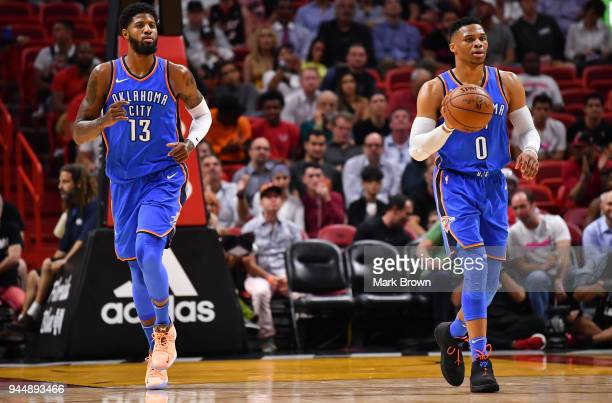 Russell Westbrook of the Oklahoma City Thunder in action moving the ball up the court with Paul George during the game against the Miami Heat at...