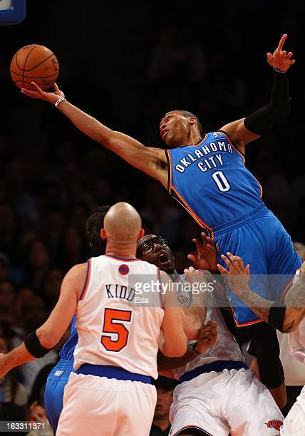 Russell Westbrook of the Oklahoma City Thunder is called for an offensive foul as he collides with Amar'e Stoudemire of the New York Knicks March 7...