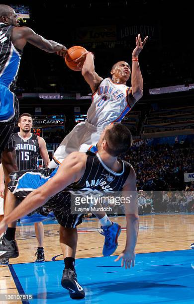 Russell Westbrook of the Oklahoma City Thunder is called for charging against Ryan Anderson of the Orlando Magic during an NBA game on December 25...