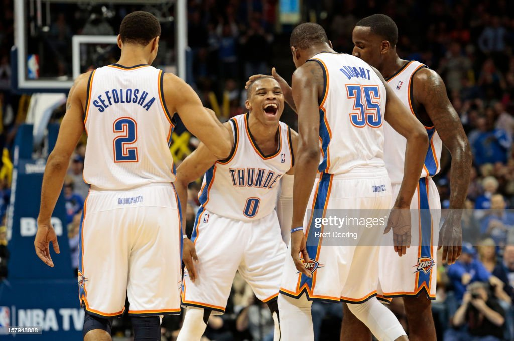 Russell Westbrook #0 of the Oklahoma City Thunder is congratulated by the team after making a three-point shot while getting fouled against the Los Angeles Lakers on December 7, 2012 at Chesapeake Energy Arena in Oklahoma City, Oklahoma.