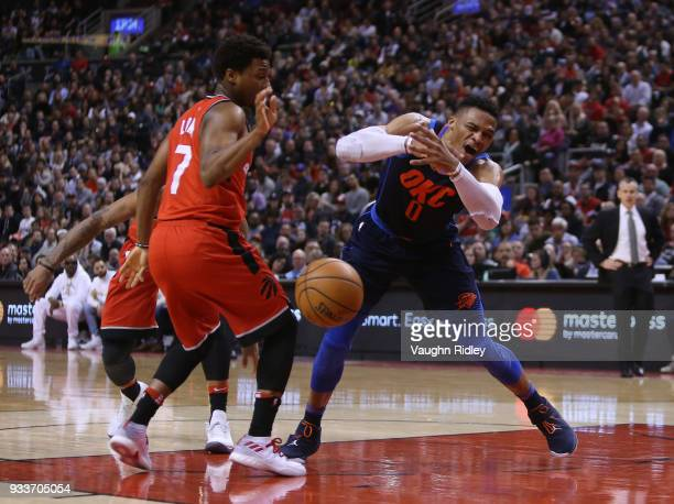 Russell Westbrook of the Oklahoma City Thunder is fouled by Kyle Lowry of the Toronto Raptors during the first half of an NBA game at Air Canada...