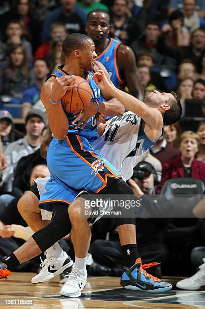 Russell Westbrook of the Oklahoma City Thunder knocks over Jose Juan Barea of the Minnesota Timberwolves as he drives to the basket during the first...