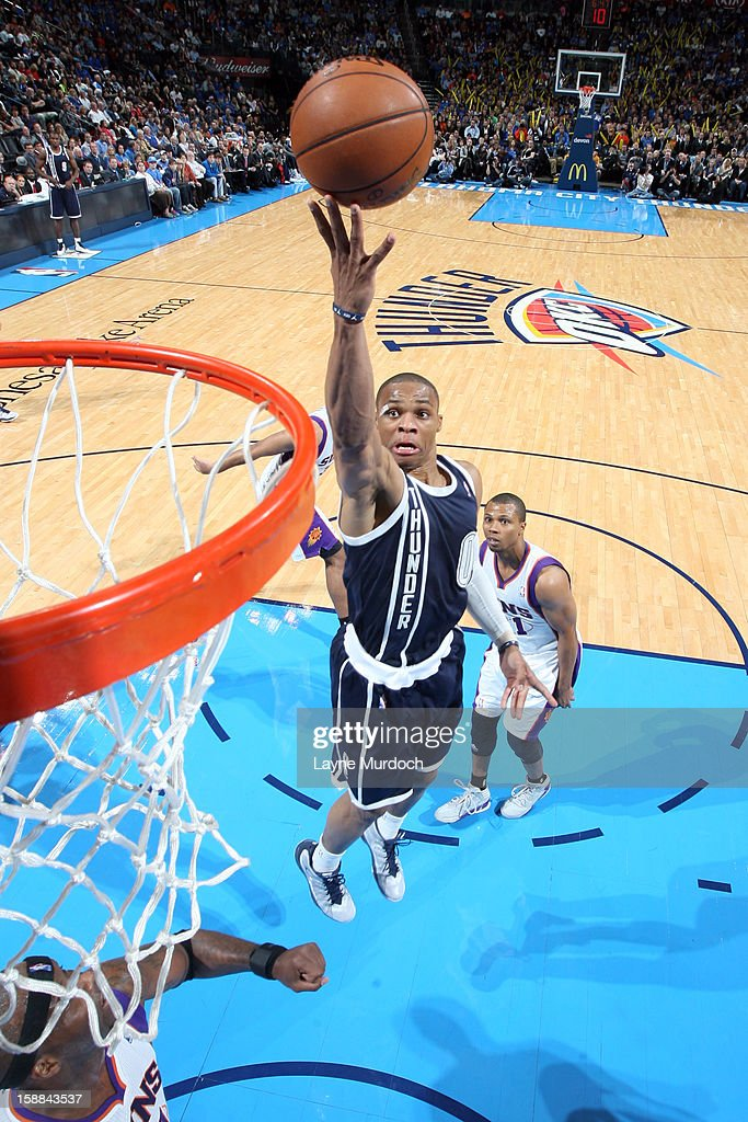 Russell Westbrook #0 of the Oklahoma City Thunder lays the ball up against the Phoenix Suns during an NBA game on December 31, 2012 at the Chesapeake Energy Arena in Oklahoma City, Oklahoma.