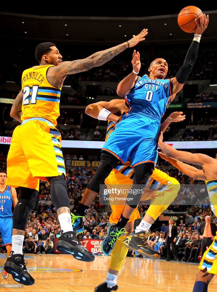 Russell Westbrook #0 of the Oklahoma City Thunder lays up a shot against Wilson Chandler #21 of the Denver Nuggets at the Pepsi Center on January 20, 2013 in Denver, Colorado.