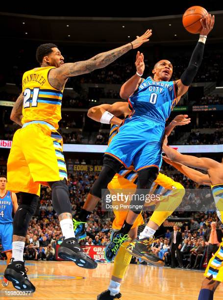 Russell Westbrook of the Oklahoma City Thunder lays up a shot against Wilson Chandler of the Denver Nuggets at the Pepsi Center on January 20 2013 in...