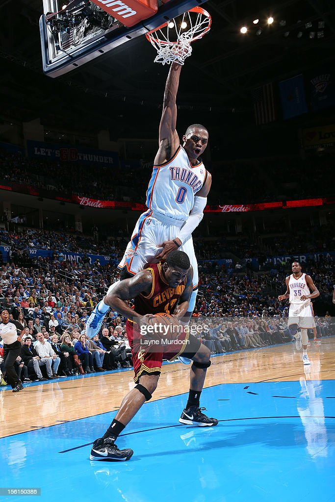 Russell Westbrook #0 of the Oklahoma City Thunder leapfrogs over a member of the Cleveland Cavaliers during an NBA game on November 11, 2012 at the Chesapeake Energy Arena in Oklahoma City, Oklahoma.