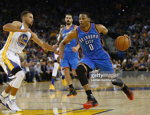 Russell Westbrook of the Oklahoma City Thunder looks to drive past Stephen Curry of the Golden State Warriors at ORACLE Arena on November 3 2016 in...