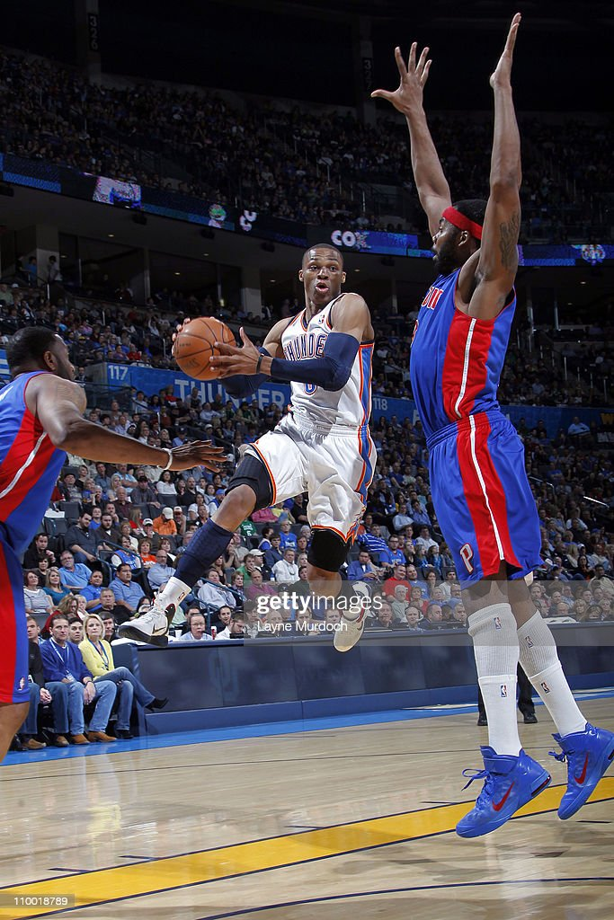 Russell Westbrook #0 of the Oklahoma City Thunder looks to pass against Chris Wilcox #9 of the Detroit Pistons during the game on March 11, 2011 at the Oklahoma City Arena in Oklahoma City, Oklahoma.