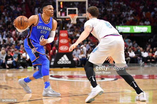 Russell Westbrook of the Oklahoma City Thunder looks to pass during the game against the Miami Heat at American Airlines Arena on April 9 2018 in...
