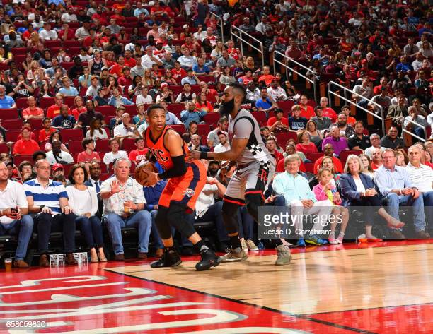 Russell Westbrook of the Oklahoma City Thunder looks to pass the ball against James Harden of the Houston Rockets on March 26 2017 at the Toyota...