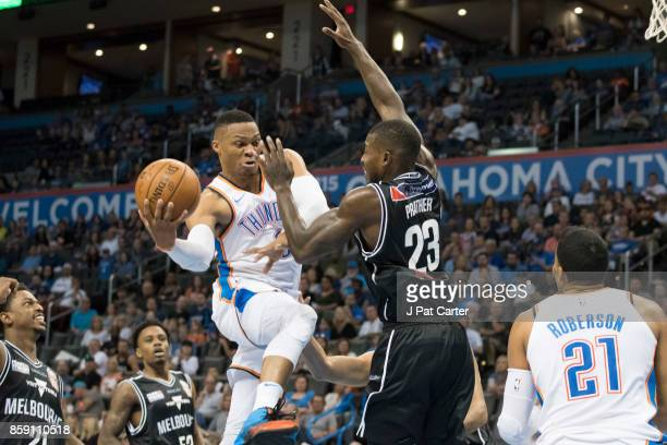 Russell Westbrook of the Oklahoma City Thunder looks to pass the ball as Casey Prather of Melbourne United in the first half a NBA preseason game at...