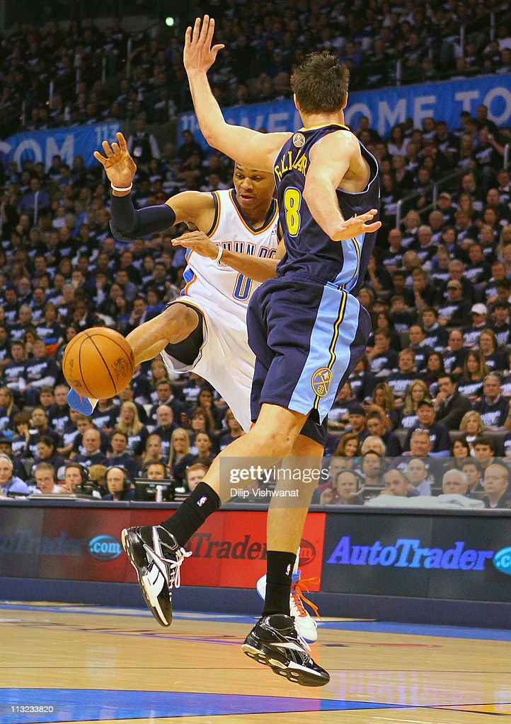 Russell Westbrook #0 of the Oklahoma City Thunder looses control of the ball against Danilo Gallinari #8 of the Denver Nuggets in Game Five of the Western Conference Quarterfinals in the 2011 NBA Playoffs on April 27, 2011 at the Ford Center in Oklahoma City, Oklahoma.
