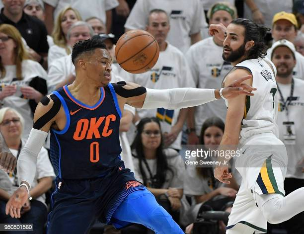 Russell Westbrook of the Oklahoma City Thunder loses the ball while being guarded by Ricky Rubio of the Utah Jazz in the first half during Game Four...