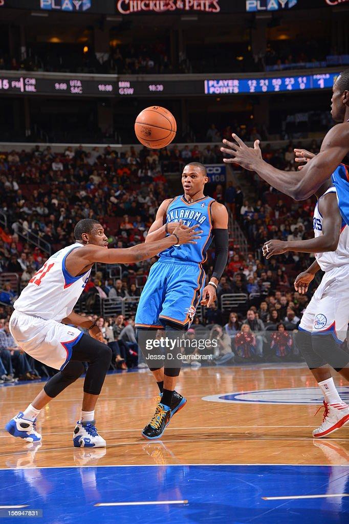 Russell Westbrook #0 of the Oklahoma City Thunder makes a pass against the Philadelphia 76ers at the Wells Fargo Center on November 24, 2012 in Philadelphia, Pennsylvania.