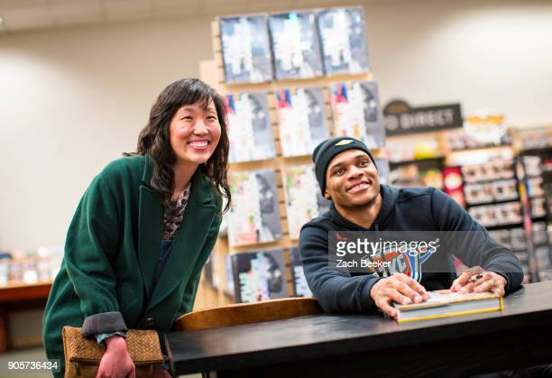 Russell Westbrook of the Oklahoma City Thunder meets with fans and autographs copies of his book 'Russell Westbrook Style Drivers' at Barnes and...