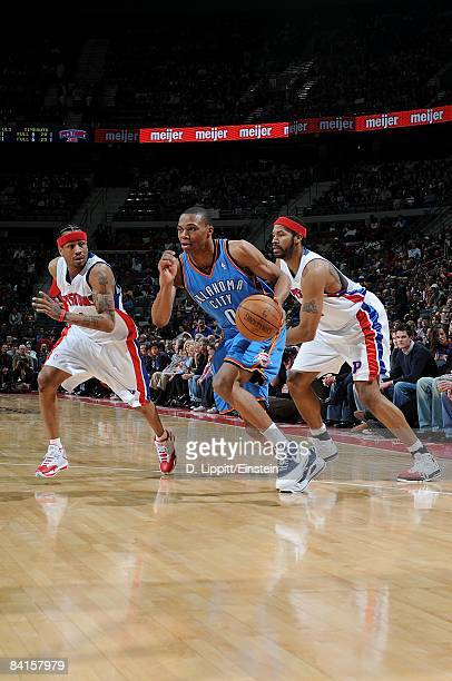 Russell Westbrook of the Oklahoma City Thunder moves the ball against Allen Iverson of the Detroit Pistons during the game on December 26 2008 at The...