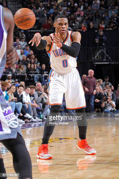 Russell Westbrook of the Oklahoma City Thunder passes against the Sacramento Kings on November 23 2016 at Golden 1 Center in Sacramento California...