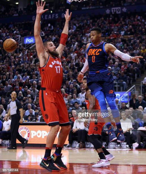 Russell Westbrook of the Oklahoma City Thunder passes the ball as Jonas Valanciunas of the Toronto Raptors defends during the first half of an NBA...