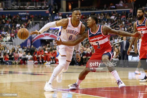 Russell Westbrook of the Oklahoma City Thunder passes the ball against Bradley Beal of the Washington Wizards during the first half at Capital One...