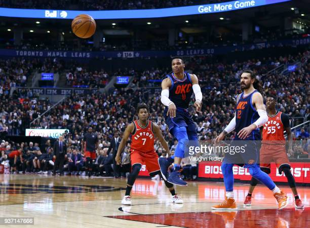 Russell Westbrook of the Oklahoma City Thunder passes the ball during the first half of an NBA game against the Toronto Raptors at Air Canada Centre...
