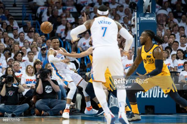 Russell Westbrook of the Oklahoma City Thunder passes the ball Carmelo Anthony of the Oklahoma City Thunder during game 2 of the Western Conference...