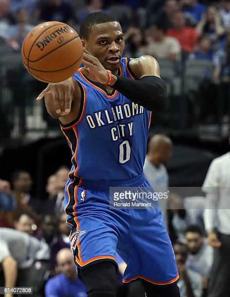Russell Westbrook of the Oklahoma City Thunder passes the ball against the Dallas Mavericks during a preseason game at American Airlines Center on...