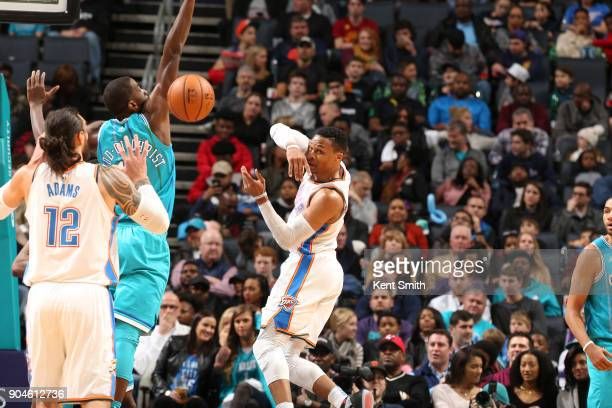 Russell Westbrook of the Oklahoma City Thunder passes the ball against the Charlotte Hornets on January 13 2018 at Spectrum Center in Charlotte North...