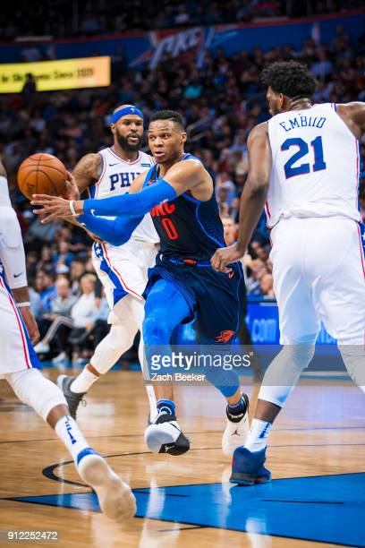 Russell Westbrook of the Oklahoma City Thunder passes the ball against the Philadelphia 76ers on January 28 2018 at Chesapeake Energy Arena in...