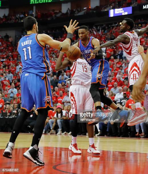 Russell Westbrook of the Oklahoma City Thunder passes the ball to Enes Kanter defended by Patrick Beverley of the Houston Rockets in the second half...