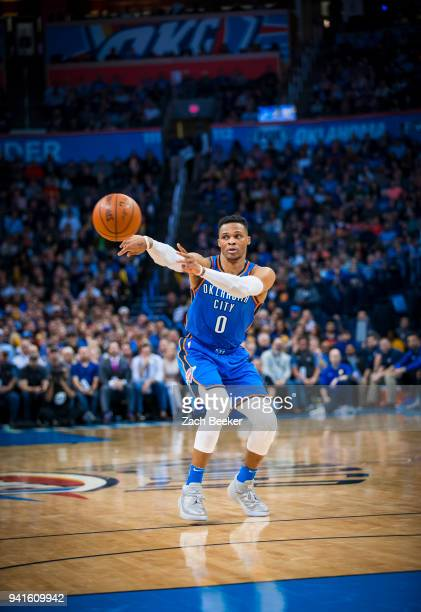 Russell Westbrook of the Oklahoma City Thunder passes the ball to teammate against the Golden State Warriors on April 3 2018 at Chesapeake Energy...