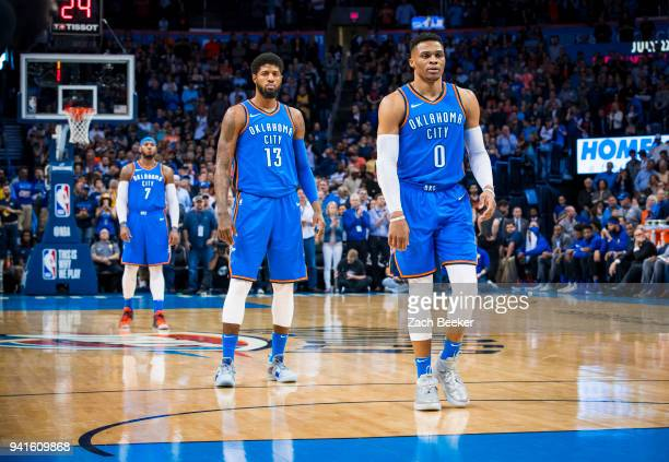 Russell Westbrook of the Oklahoma City Thunder Paul George of the Oklahoma City Thunder and Carmelo Anthony of the Oklahoma City Thunder look on...