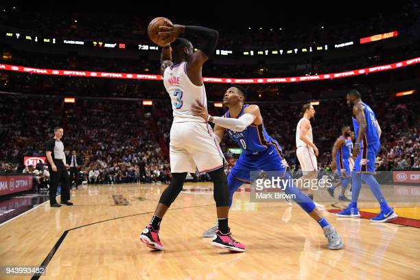 Russell Westbrook of the Oklahoma City Thunder plays defense against Dwyane Wade of the Miami Heat in the game between the Miami Heat and the...