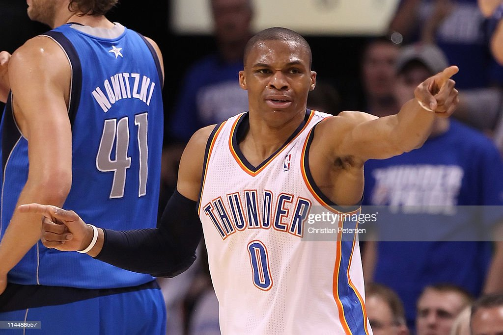 Russell Westbrook #0 of the Oklahoma City Thunder points in the third quarter while taking on the Dallas Mavericks in Game Three of the Western Conference Finals during the 2011 NBA Playoffs at Oklahoma City Arena on May 21, 2011 in Oklahoma City, Oklahoma.