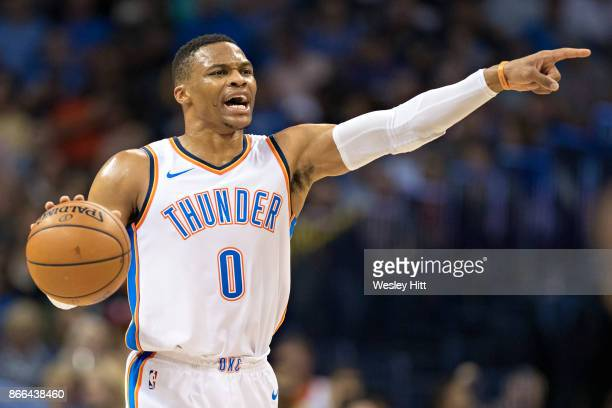 Russell Westbrook of the Oklahoma City Thunder points to his team during a game against the Indiana Pacers at the Chesapeake Energy Arena on October...