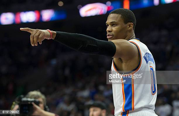 Russell Westbrook of the Oklahoma City Thunder points to the Philadelphia 76ers bench prior to the game at Wells Fargo Center on October 26 2016 in...