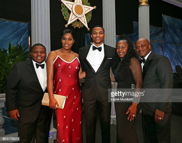 Russell Westbrook of the Oklahoma City Thunder poses for a photo with his family Ray Westbrook Nina AnnMarie Westbrook Shannon Westbrook and Russell...