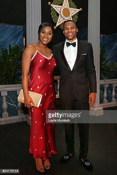 Russell Westbrook of the Oklahoma City Thunder poses for a photo with his wife Nina AnnMarie Westbrook before he is inducted into the Oklahoma Hall...