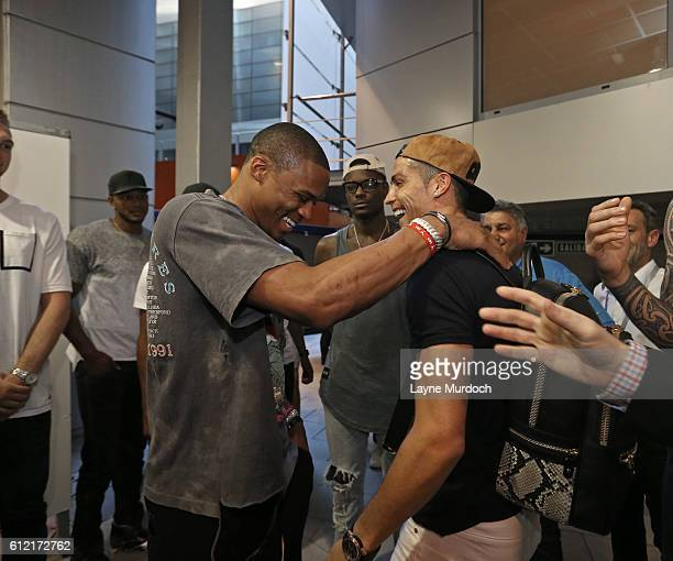 Russell Westbrook of the Oklahoma City Thunder poses with Ronaldo of the Real Madrid Football Team after the game against Einar as part of the 2016...